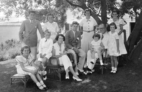 A portrait of the Kennedy Family. Seated from left are: Patricia Kennedy, Robert Kennedy , Rose Kennedy, John F Kennedy, Joseph P Kennedy Sr. with Edward Kennedy on his lap; standing from left are: Joseph P Kennedy Jr., Kathleen Kennedy, Rosemary Kennedy, Eunice Kennedy, and Jean Kennedy.