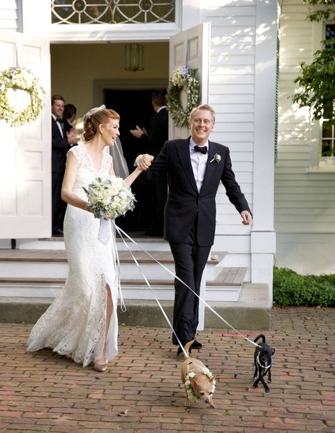 Annabel and Andrew leaving the church with flower dogs Beatrice and Bell.