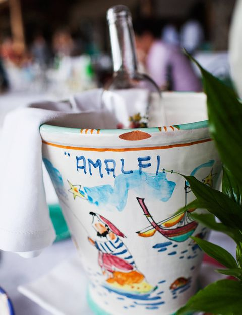 Decorative wine buckets on display at the rehearsal dinner.