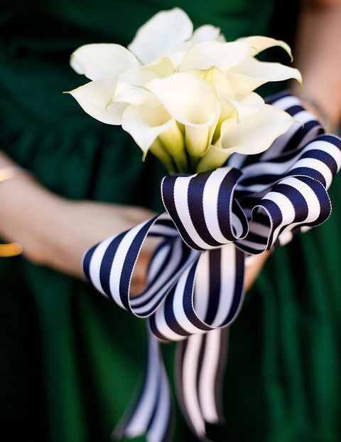 Navy and white striped ribbons secured the bridesmaid bouquets.