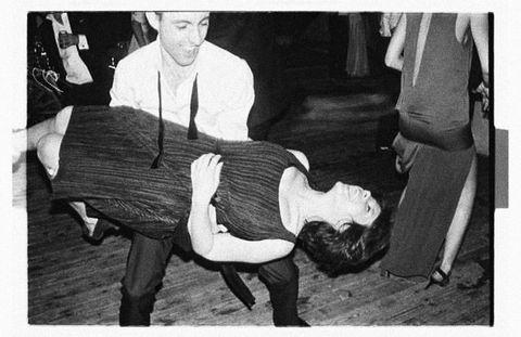 Leg, Photograph, Knee, Black-and-white, Lap, Vintage clothing, Ankle, Stock photography, Photo caption, Sock,