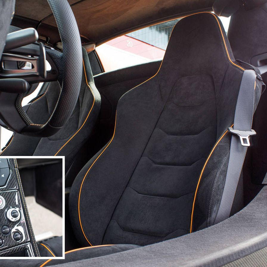 """The interior is intimate—the two seats are positioned close together to bring both passengers toward the center of gravity for balance and speed. But the big improvement in this new McLaren has come at either end of the performance spectrum. Two knobs on the center console offer three options—normal, sport, and track modes—in both performance and handling (i.e., engine and suspension). In so called normal mode, the 650S feels quite cushioned, quiet, and luxurious. You could comfortably make use of the cup holders that McLaren has provided in a concession to the American market. At the other end, in full track mode, the 650S feels like a true race car. """"It'll get your attention,"""" as one understated racer put it, with features like a wind spoiler that flips up at speeds over 70 and something called """"brake steer""""—a bit of engineering that was quickly outlawed in F1 but is still available to McLaren customers—that provides individual braking on selective wheels to bring the car in and out of a curve faster."""