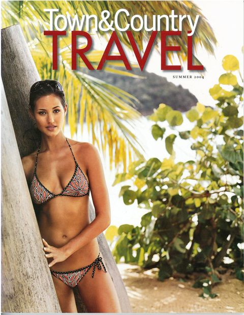 Our cover model takes shade under the palm trees in Antigua.