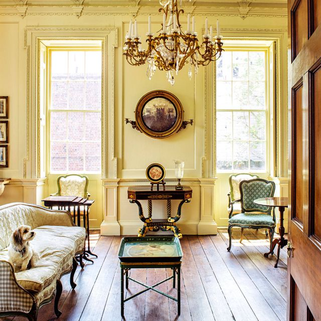 a downstairs room, furnished in colonial style
