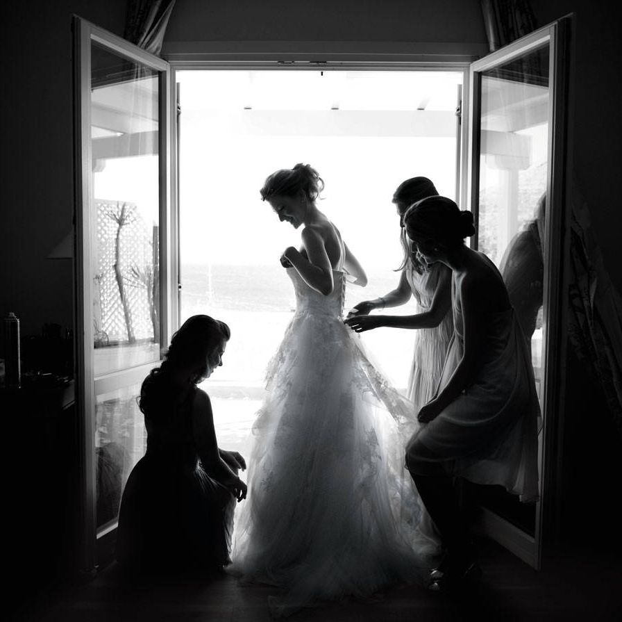 <p>Phoebe gets dressed with the help of her sisters Sophia, Vasi, and Irina.</p>