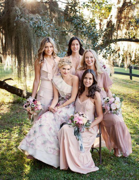 Clothing, Smile, Dress, Petal, Bridal clothing, Trousers, Event, Bouquet, Photograph, Wedding dress,