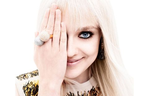 "DAKOTA FANNING was just five years old and living with her parents and one-year-old sister in the small town of Conyers, Georgia, when, as she tells it, she and her mother had a heart-to-heart regarding her proto–movie star career trajectory. In the end they came to what she describes as a mutual decision: to move from their home, 20 miles southeast of Atlanta—where they were part of an athletic extended clan, and practicing Southern Baptists—to Los Angeles, where the only things anybody worships are fame and box office loot. There she would see if she could build on the success she had had being standout cute in community theater.Which might sound a bit implausible if it weren't coming from Fanning, who is a lively, confident, and apparently quite undamaged 20-year-old woman, despite growing up on the big and small screens. What five-year-old is that methodical in pursuing her ambitions? Surely her parents pushed her to perform, at least subliminally? Her mother Joy is a former professional tennis player who majored in fashion merchandising and who, by Dakota's own accounting, gave up everything for her daughter. Her father Steven is a former minor league baseball player. So, at least from afar, they seem to fit the bill of the cliché of living vicariously through their children, for there are two stars in the family: Dakota and her fashion plate younger sister, Elle (who is appearing in Maleficent this summer).But no, Dakota insists, a bit impatiently, it was all basically her idea. ""It's hard to explain to someone who didn't know me as a child,"" she says, looking me right in the eye. ""But even before I started working—when I was two, three, four, five—I was an exceptionally mature child. I just was. And my mom and I were able to have conversations like, 'Do you want to go to California and go to auditions for commercials and TV shows? Is that something you want to do?' And I was like, 'Yeah, let's give it a try.' ""Above: Louis Vuitton blouse ($6,650)."