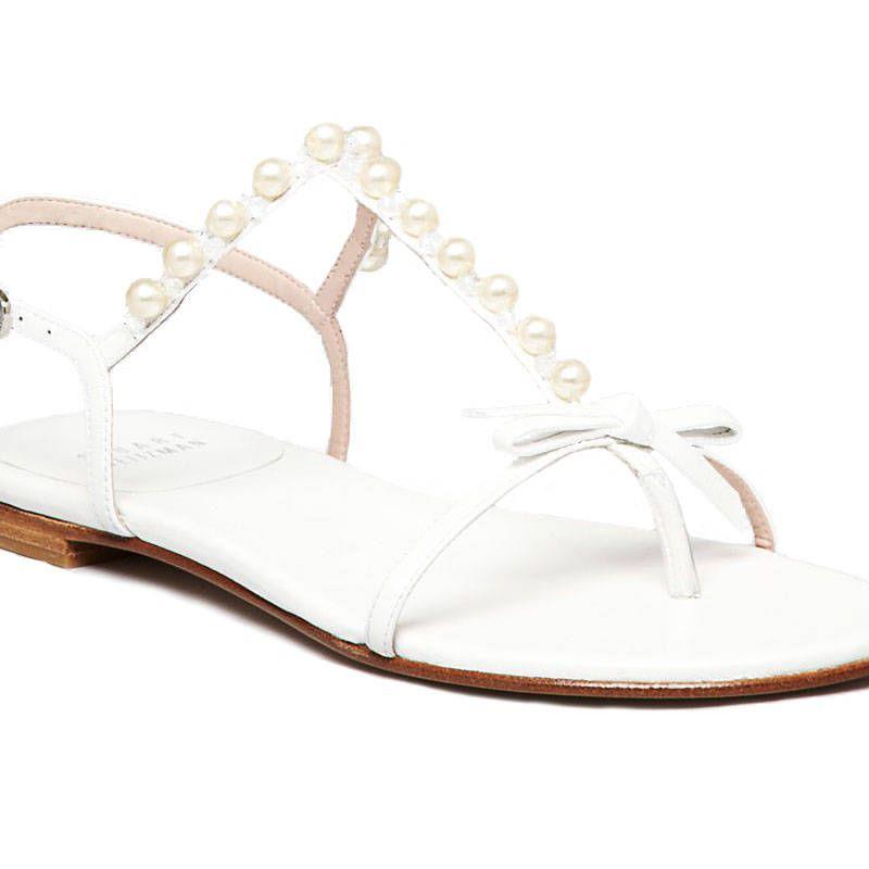 "<p>Stuart Weitzman Pearlize Flat Sandals, $278.60&#x3B; <a href=""http://www1.bloomingdales.com/shop/product/stuart-weitzman-flat-sandals-pearlize?ID=912746&PartnerID=LINKSHARE&cm_mmc=LINKSHARE-_-n-_-n-_-n&LinkshareID=Hy3bqNL2jtQ-hnz6RRZinfg800eeFQ6xmg"" target=""_blank"">bloomingdales.com</a></p>"