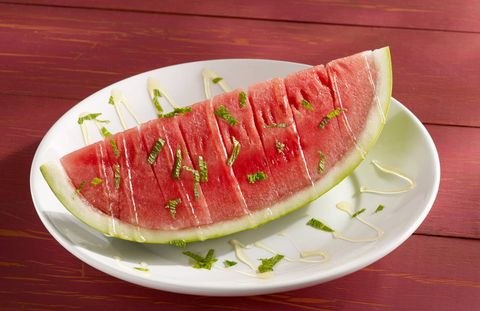 Ingredients:    •    1 cup(s) (from 6 to 7 limes) fresh lime juice    •    1/4 cup(s) honey    •    1 (about 12 pounds) ripe watermelon, chilled, quartered lengthwise, and cut into thick slicesDirections    1.  In 2-quart saucepan, heat lime juice and honey to boiling on high, stirring occasionally. Boil 2 minutes. Remove from heat. Transfer to small bowl and refrigerate until cold. Syrup can be refrigerated up to 1 day ahead.    2. Place watermelon slices on large platter. Drizzle with lime syrup and serve immediately.via Delish.com