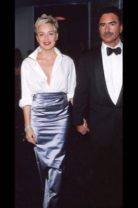 What: Her husbands shirt and Vera Wang skirtWhere: Academy Awards in 1998Why: Stone proved style is about originality when she styled her husband's oxford shirt with an evening skirt.
