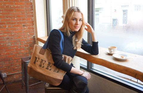Sitting, Comfort, Street fashion, Brown hair, Brick, Coffee cup, Serveware, Brickwork, Portrait photography, Boot,