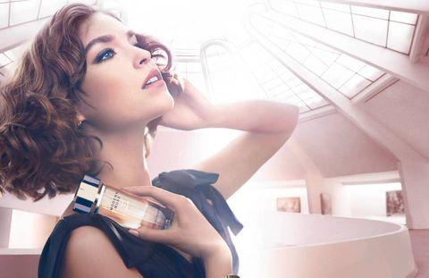 Lip, Hand, Wrist, Eyelash, Fashion accessory, Beauty, Model, Long hair, Brown hair, Blond,