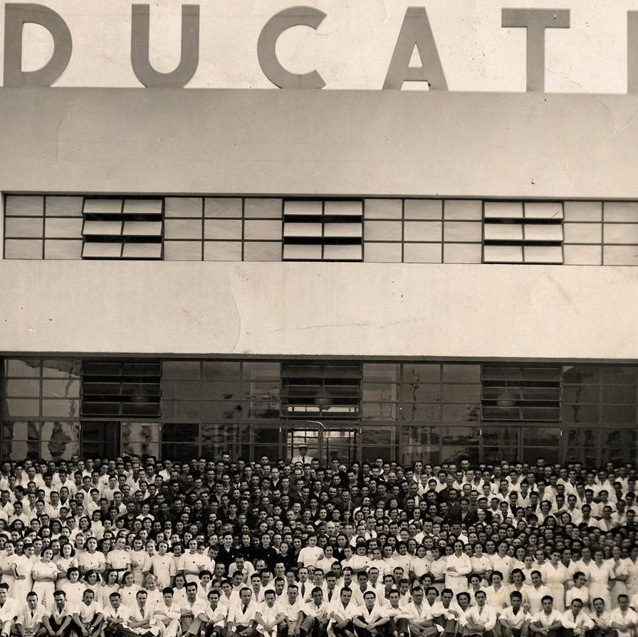Workers gather for a portrait at the Ducati factory in Bologna, 1939.