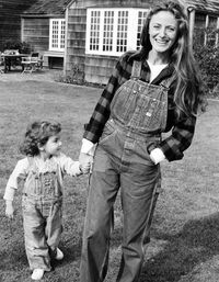 <p>The ever-elegant Ricky Lauren, with daughter Dylan, outside her East Hampton home, 1977.</p>
