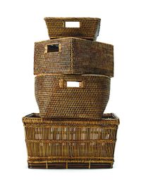 """Prevent the """"chairdrobe"""" (def. """"The art of putting clothes on a chair to be used in place of closet or dresser&#x3B; via urbandictionary.com) by purchasing new baskets, like these rattan rectangular linen baskets with handles from Waterworks."""