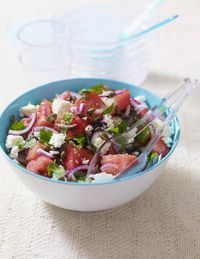 Ingredients:2 tablespoon(s) olive oil                                                                                              1 tablespoon(s) white wine vinegar1 tablespoon(s) fresh lime juiceKosher salt and pepper1/4 small red onion, thinly sliced1 piece(s) (1-lb) seedless watermelon1/2 seedless cucumber, sliced into half moons3 cup(s) baby arugula3 ounce(s) (about 3/4 cup) feta cheese, crumbledDirections1. In a large bowl, whisk together the oil, vinegar, lime juice, and 1/4 tsp each salt and pepper. Add the onion and let sit, tossing occasionally, for 10 minutes. 2. Meanwhile, remove and discard the watermelon rind. Cut the watermelon into thin 2-in. pieces.3. Add the watermelon, cucumber and arugula to the bowl of onions and gently toss to combine. Top with the feta.via Delish.com
