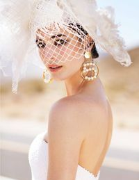 Romona Keveza dress, vintage Chanel earrings, Trivial New York hat.