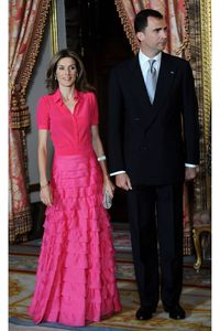A brightly-hued ensemble ensures the royal stands out as hostess at a gala honoring the King of Saudi Arabia.