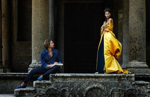 Despite the monumental distractions of Italy's Sacred Wood of Bomarzo, his gaze rested only on her. Wes Gordon cloak ($12,675); Max Mara pants ($895); Proenza Schouler shoes ($695). On him, Brunello Cucinelli shirt ($495); Louis Vuitton pants ($1,175); CB Made in Italy slippers ($400); his own necklace.Styled by Sophie Pera