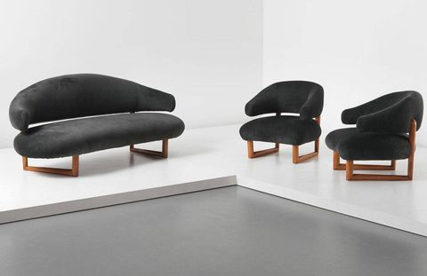 A grand array of objects created by some of the most revered names in design are set to hit the auction block Thursday, September 26th at Phillips in London.  The Design sale's and Nordic Design sales's purview stretches back over the 20th century to include masters like Giacometti, Ponti, and Wegner alongside contemporary stars like Tom Dixon and the Campana brothers. T&C walked through the exhibit with the director of the New York design department, Alex Heminway, who spoke about a few of his favorite pieces:We have a suite by Jean Royère coming from an important New York collector. Royère was one of the great midcentury designers who was forgotten about for a while and then rediscovered at the flea markets by certain French gallerists who became instrumental in igniting his market.Above: Lot 7 Jean Royère, 'Sculpture' sofa and pair of armchairs, circa 1956. Estimate: $312,000-$467,000