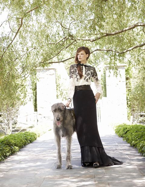 It's a rare creature who can pull off a floor-sweeping gown — and an unusually large dog — in the middle of the day.Jason Wu silk chiffon lace embroidered blouse ($1,740); Bill Blass silk georgette skirt ($1,675).