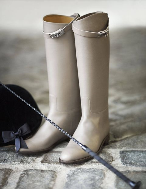 Mementos scattered on the bridle path. Hermès leather Jumping Lady boots ($2,250)&#x3B; Charles Owen Rider helmet ($118) and Beval crop (from $15).