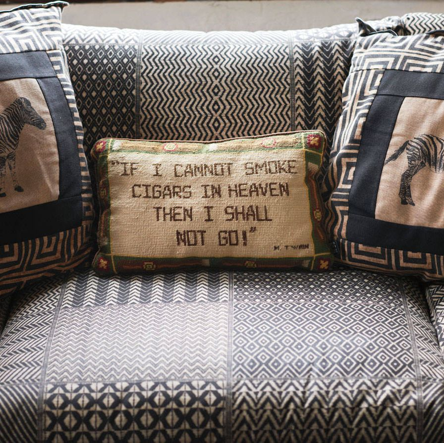 Pillows with zebras and a tobacco-friendly sentiment in the den.