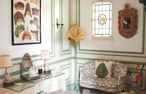 A powder room reveals a feminine side to the house.