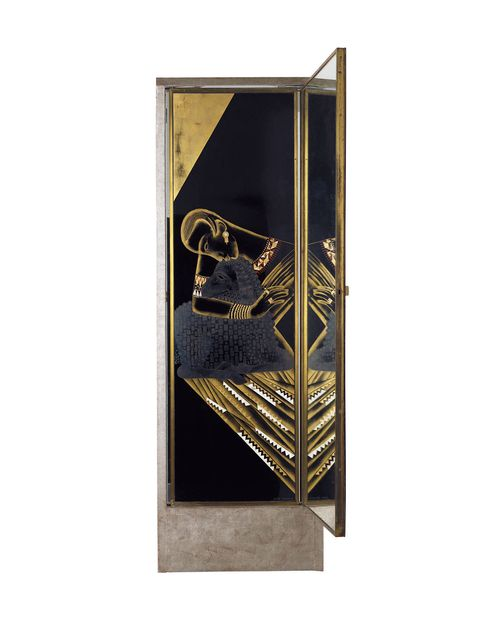 This is a spectacular mirror by Jean Dunand. It was commissioned by Madame Agnés and appeared in her showroom for clients. He is a master of lacquer and in this triptych one side shows classic art deco shapes and the other side, a depiction of St. Agnes.Lot 37 Jean Dunand, Important and unique illuminated triptych psyché, designed for Madame Agnés, Salon de la rue Saint-Florentin, Paris, 1926. Estimate: $187,000-$280,000SOLD: $272,472