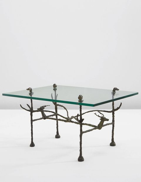 This trapezoidal low table by Diego Giacometti was designed in the mid-60s, but it was probably produced in the 1980s. He also did a model with frogs and owls instead of deer and dogs. What's great about Diego is that, unlike his brother who focused on human forms, he often molded animals. There is a lot of warmth and humor in his work. Lot 42 Diego Giacometti, 'Trapézoïdale' low table, model 'cerfs et aux chiens,' conceived circa 1963, executed circa 1980. Estimate: $156,000-$234,000SOLD: $196,212