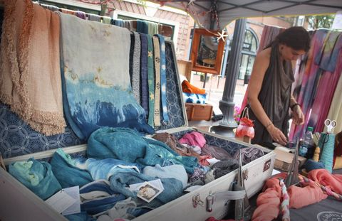 Textile, Market, Human settlement, Teal, Selling, Marketplace, Waste, Plastic, Trade, Paint,