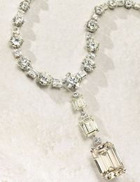 Suspending a detachable pendant, set with three rectangular-cut diamonds, weighing approximately 81.38, 15.30 and 7.04 caratsEstimate: $2,800,000 – $3,500,000