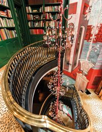 Wilkinson designed the chandeliers, by Remains Lighting, that illuminate his house's grand staircase.