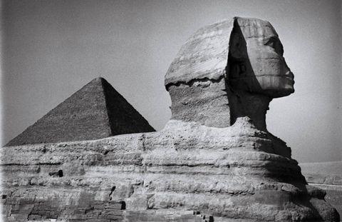 Pyramid, Rock, Landmark, Ancient history, History, Monochrome photography, Sculpture, Bedrock, Monument, Black-and-white,