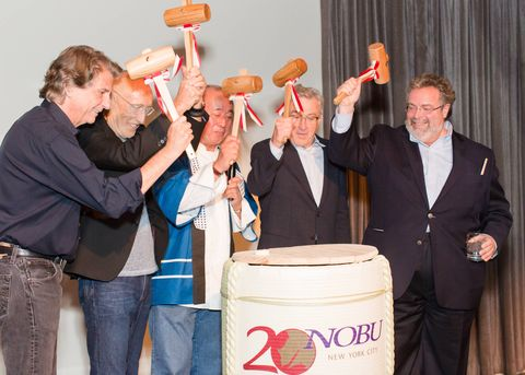 On Wednesday night in New York City more that 600 friends and fans gathered at Tribeca Rooftop to kick-off a year-long Nobu 20th anniversary celebration. Notable guests who came to congratulation Chef Nobu Matsuhisa included Robert De Niro, chef Thomas Keller, producer Meir Teper, and restauranteur Drew Nieporent. Against the backdrop of a traditional Japanese street festival we snacked on classic dishes, such as the yellowtail jalapeño, rock shrimp creamy spicy, and some new additions like the FIJI Water shaved ice dessert. The saying seems to hold true for Nobu—it does just get better with age!