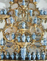 The problem of how to display a group of blue and white Chinese vases of similar scale is solved by placing them on a gilded Rococo mirror, which emphasizes their sameness.