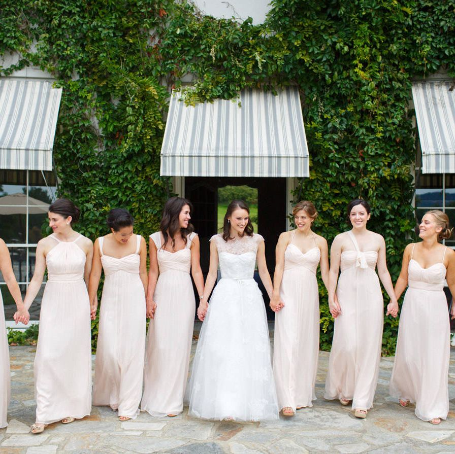 Bridesmaid dresses: Amsale.Bridesmaid gifts: Jennifer Meyer gold thin rings in assorted stones for each bridesmaid.