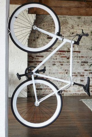 Soporte vertical para bicicletas montado en la pared