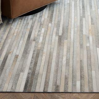 Striped cowhide rug