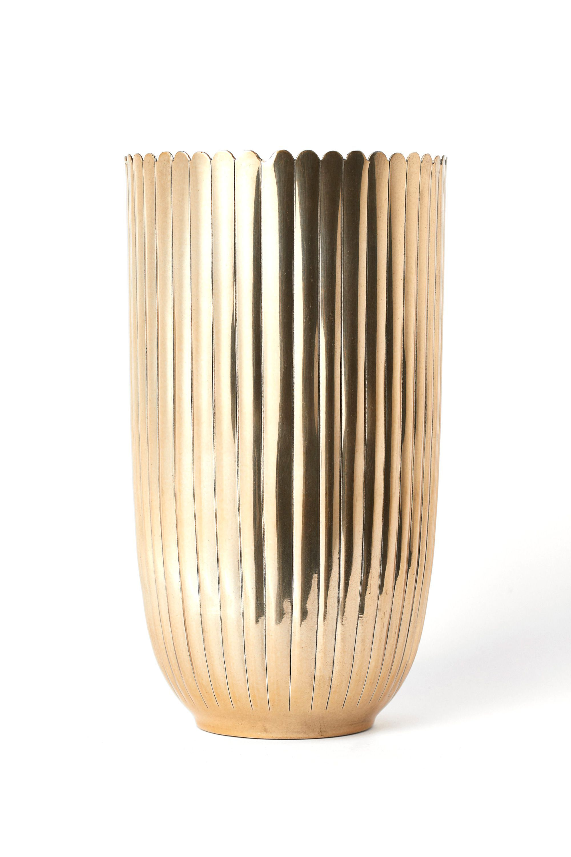 Tall Metal Vase H&M hm.com $24.99 SHOP NOW A bouquet of flowers is a standard Mother's Day gift, but present them in this glam vase instead.