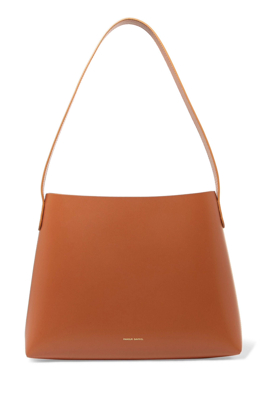 """Small Hobo leather shoulder bag Mansur Gavriel net-a-porter.com $545.00 SHOP NOW This roomy bag screams """"I'm a chic mom."""""""