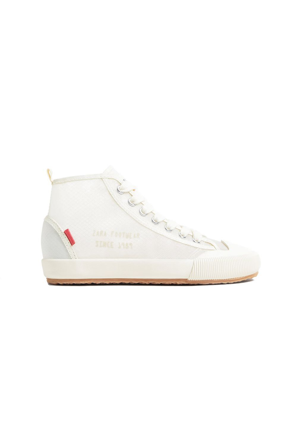 Translucent High Top Sneakers Zara zara.com $39.90 SHOP IT Take the opportunity to show off your funky collection of socks with this see-through high top sneaker. The footwear maintains that clean, crisp white look, but not in a boring conformist way.