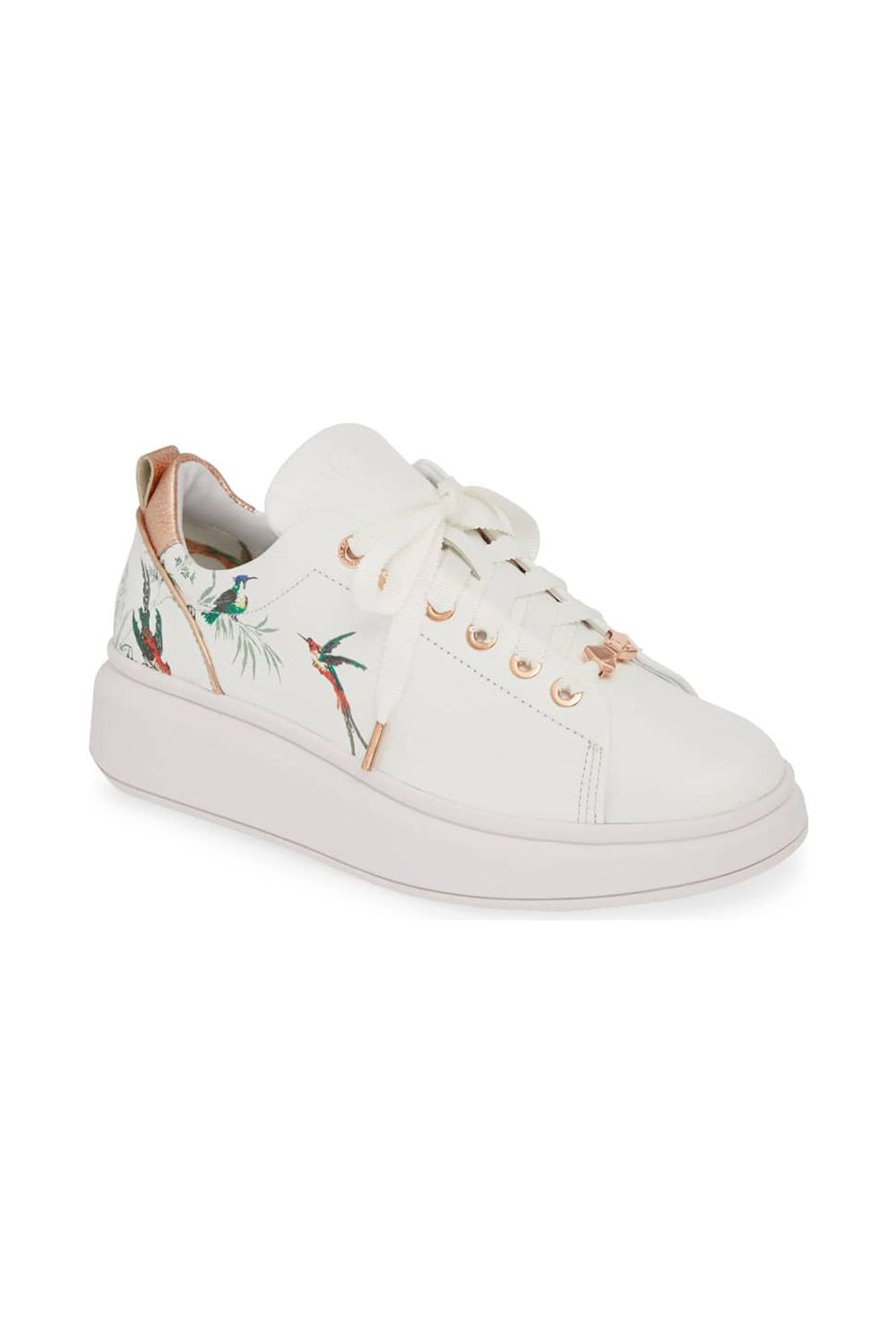 Ailbe 4 Printed Sneaker Ted Baker London nordstrom.com $199.95 SHOP IT Hummingbirds and rose-gold colored laces give this sneaker a feminine vibe, if that is what you're looking for. This sweet-as-can-be footwear pairs nicely with more masculine pieces in your wardrobe like trousers or a blazer suit set.