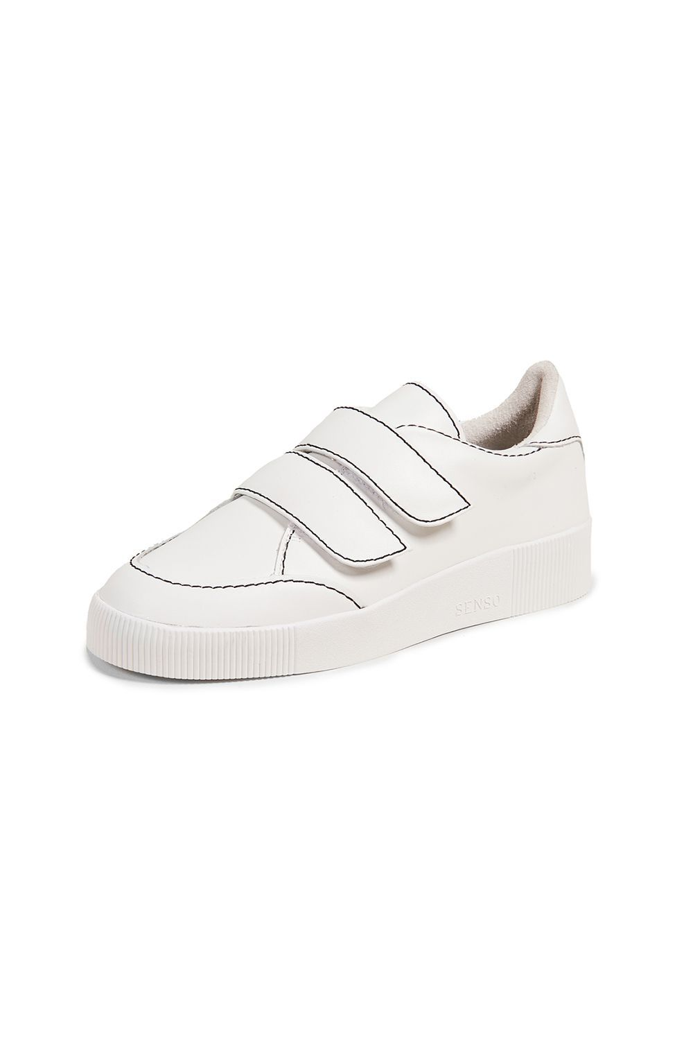 Adrianna Sneakers Senso shopbop.com $199.00 SHOP IT Velcro sneakers are cool again, and that's not a surprise if they look like this pair. The colored topstitching adds an artsy edge to the plain kicks and makes the straps pop against the shoes.