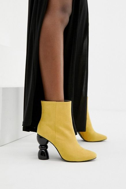 Colorful Boots with a Geometric Heel Asos DESIGN us.asos.com $64.00 SHOP IT The geometric heel trend is in full force for spring. For a pop of color on Easter weekend and beyond, slip into these affordable ($64!) yellow suede booties.