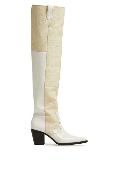 Knee-High Crocodile-Effect Leather Boots Ganni matchesfashion.com $526.00 SHOP IT Hitting just below the knee, Ganni's Nadine boots are wild in the most sophisticated way. Featuring white leather paneling and off-white crocodile-effect leather, the neutral color combination will ground all of your printed and flowing dresses.