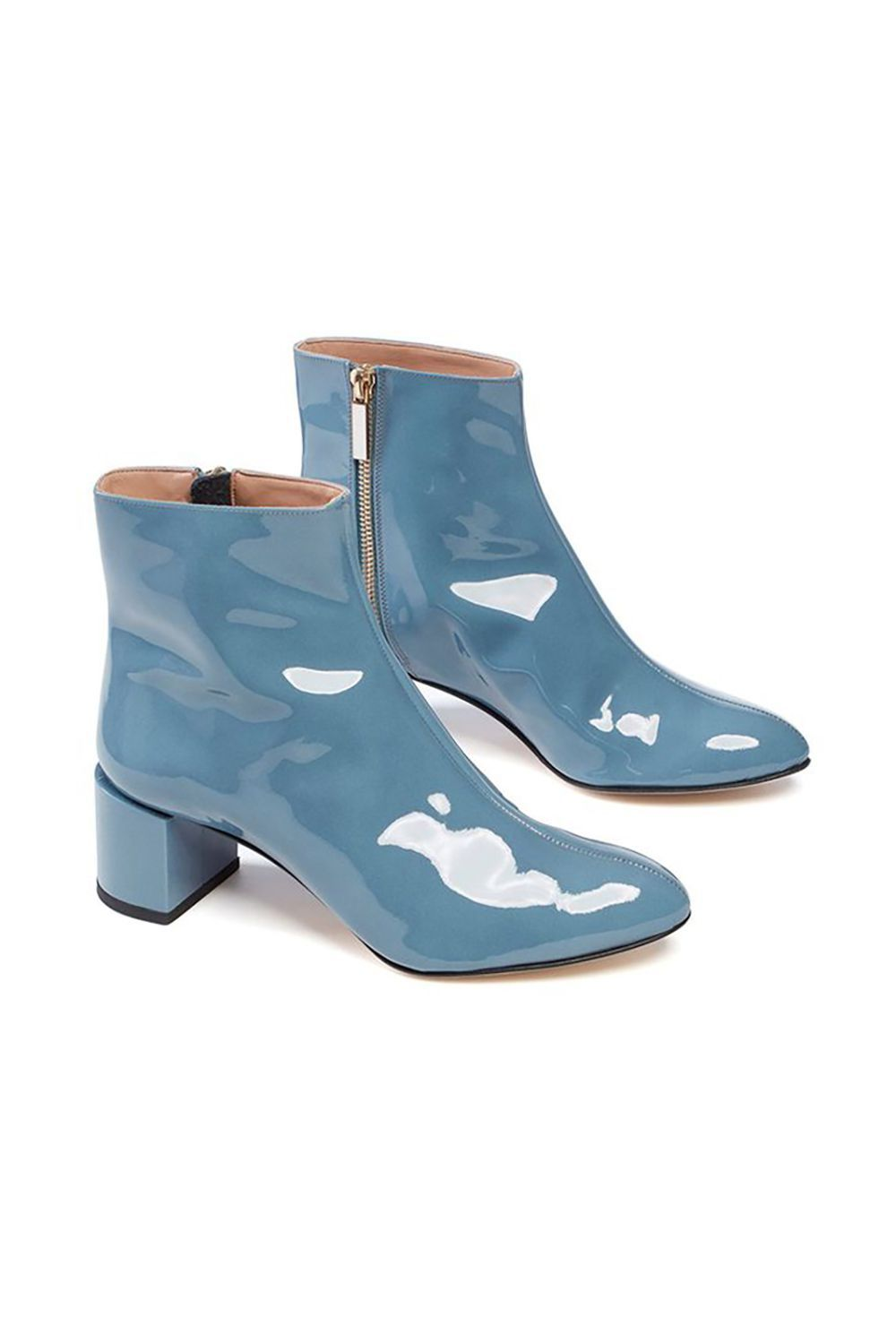 Blue Patent Leather Boots Dear Frances dearfrances.com $495.00 SHOP IT Lean into springtime pastels with these playful patent leather boots. Shiny yet sleek, this outfit-making style consistently sells out on Dear Frances' website, so make a beeline to purchase them while they're still in stock.