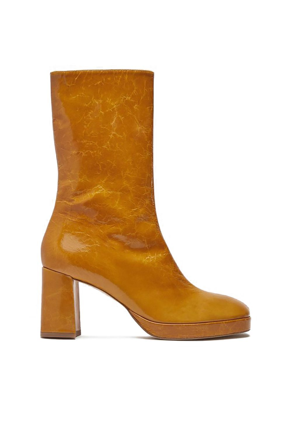 Crinkled Patent Leather Boots Miista usa.miista.com $400.00 SHOP IT Who said that crisp leafy hues are only for fall? Pair these pumpkin-spice-colored crinkled leather boots with white jeans or a skirt for an effortlessly chic, retro-inspired spring look.