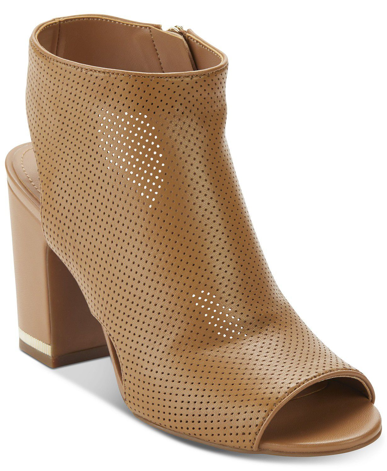Summer Booties DKNY macys.com $120.00 SHOP NOW Finding an ankle bootie that's not meant for autumn can be tricky—unless you're an editor. The amount of compliments we get when wearing ours in the warm months proves that it's a shape a lot of women want in their closet.