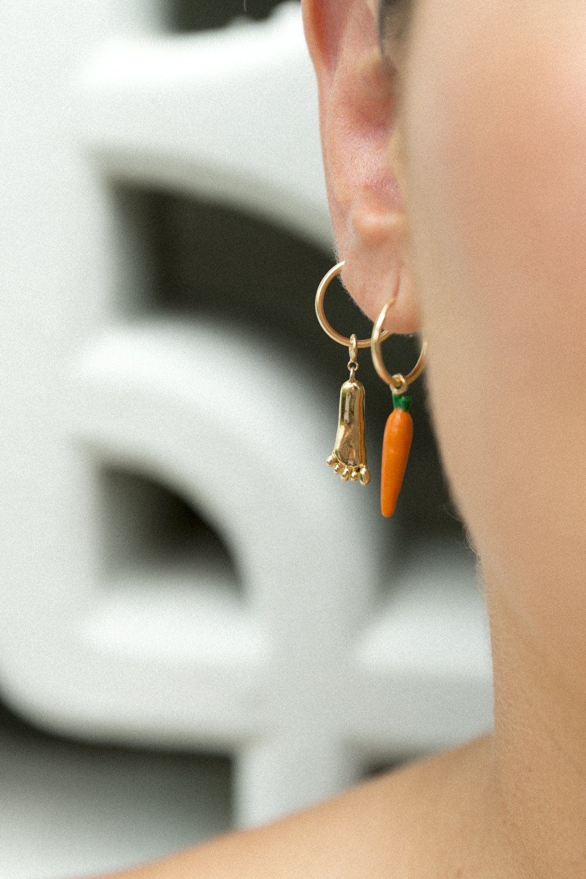 """Pilicarota Earring in Orange Pili Restrepo maison-de-mode.com $22,000.00 SHOP NOW """"There's a lot of talk about sustainable fashion but not as many people know that jewelry can - and should! - be sustainably made as well. Pili Restrepo is an ideal example of a cool company creating original designs while also respecting the environment and its workers. Every piece is handmade in NY by master artisans who use Fairmined, mercury-free and recycled 14K gold along with ethically-sourced stones."""" - Amanda Hearst"""